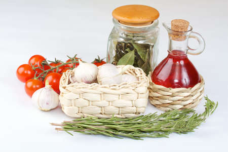 Red wine vinegar with fresh vegetables and spices isolated photo