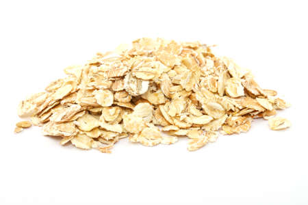 Heap of dry rolled oats isolated on white background Stock Photo - 9425465