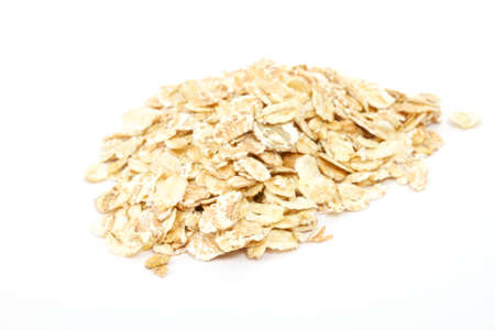 rolled: Heap of dry rolled oats isolated on white background