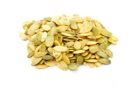 fresh pumpkin seeds isolated on a white Stock Photo