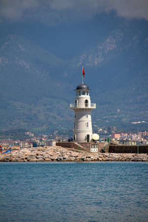 Lighthouse in port. Turkey, Alanya. Sunny weather photo