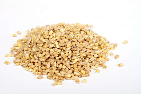 Pile of Pearl Barley isolated on white photo
