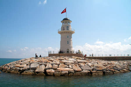 Lighthouse in port. Turkey, Alanya. Sunny weather Stock Photo - 9803537