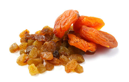 Heap of raisin and dry apricot on a white background photo