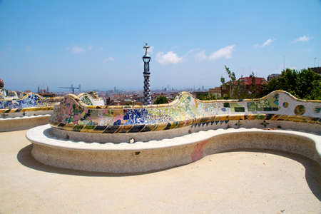 tourist attractions: BARCELONA - May 27: The surreal Parc Guell by Antoni Gaudi, one of Barcelonas most popular tourist attractions - Colorful park bench decorated with glazed ceramic mosaics May 23, 2011 in Barcelona