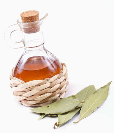 balsamic: vinegar bottle and laurel leaf on the white