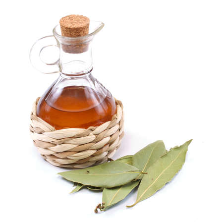 vinegar bottle and laurel leaf on the white Stock Photo - 10228920