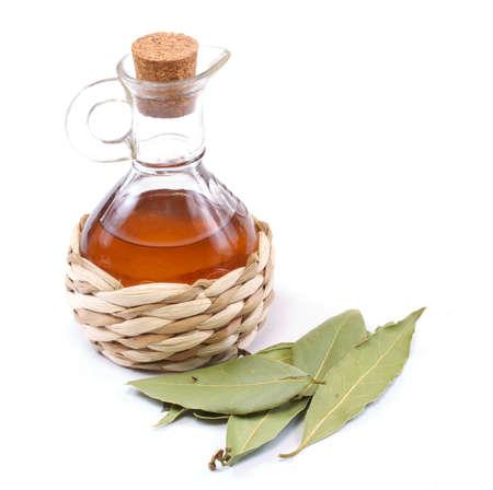 vinegar bottle and laurel leaf on the white Stock Photo - 10228920