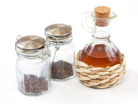 vinegar bottle, spices on the white photo