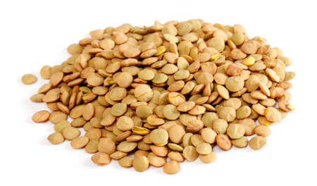 scattered: Brown lentils scattered on white background