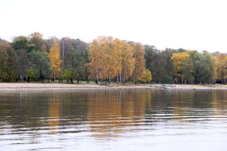 Colorful autumn trees fortress at the river front photo