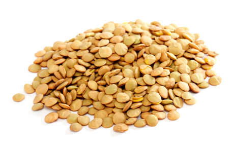 Brown lentils scattered on white background photo