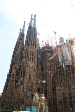 uncomplete: BARCELONA, SPAIN - May 23: La Sagrada Familia - the impressive cathedral designed by Gaudi, which is being build since 19 March 1882 and is not finished yet May 23, 2011 in Barcelona, Spain.