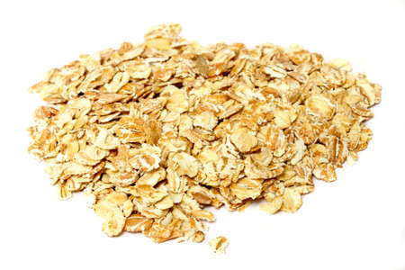 Heap of dry rolled oats isolated on white background