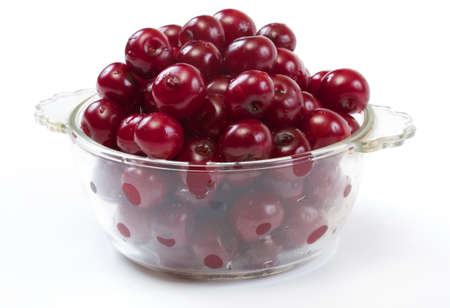 Bowl with ripe cherries. Isolated on a white background. photo