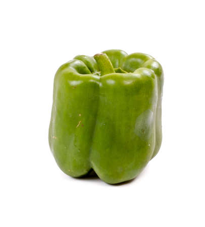 Green yellow pepper isolated on white photo