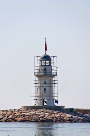 Lighthouse in port. Turkey, Alanya. Sunny weather. photo