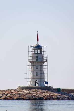Lighthouse in port. Turkey, Alanya. Sunny weather. photo