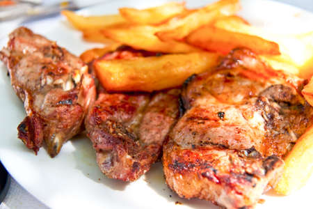 Lamp chop with french fries and tomatoes photo