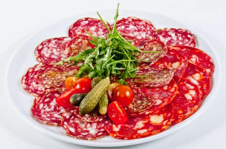 italian sausage: Italian sausage assorted with tomato, cucumber and ruccola Stock Photo