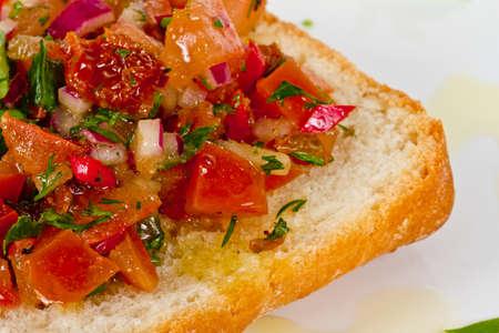 Bruschetta( Italian Toasted Garlic Bread ) with tomato photo