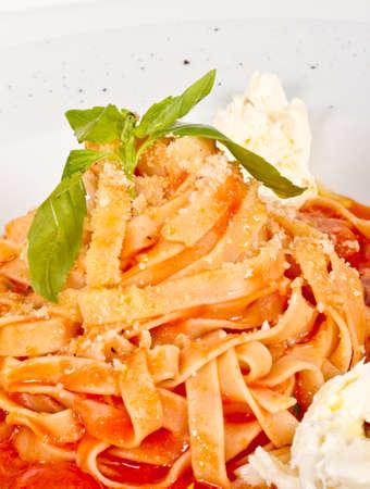 Pasta (tagliatelle) with cherry tomato and mozzarella photo