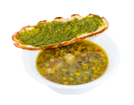 Minestrone soup with fried bread photo