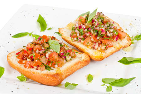 Bruschetta (Italiano Pan Tostado ajo) con tomate photo