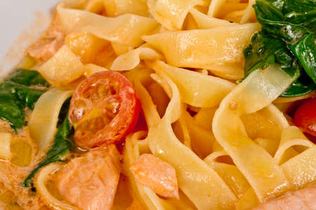 tasty pasta with cream, salmon, cheese and parsley close up Stock Photo - 12518507
