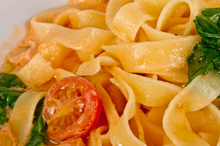 tasty pasta with cream, salmon, cheese and parsley close up Stock Photo - 12518456