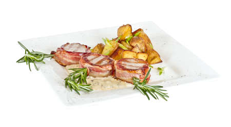 Grilled steak wrapped in bacon, with grilled vegetables photo