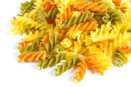 Uncooked pasta fusilli in different colours, white background Stock Photo - 12852532