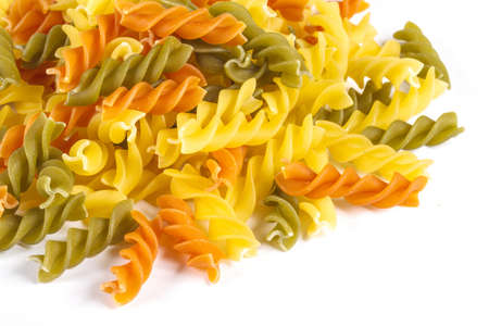 Uncooked pasta fusilli in different colours, white background Stock Photo - 12852530