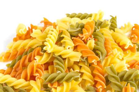 Uncooked pasta fusilli in different colours, white background Stock Photo - 12852527