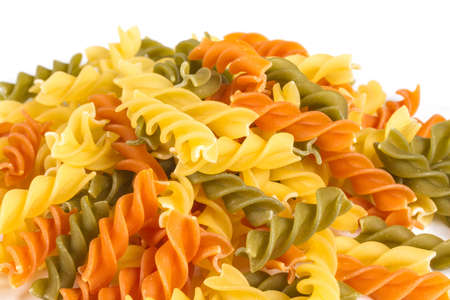 Uncooked pasta fusilli in different colours, white background Stock Photo - 12852531