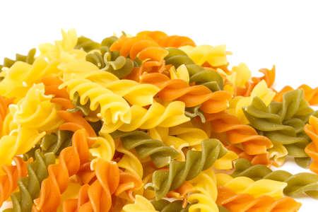 Uncooked pasta fusilli in different colours, white background Stock Photo - 12852522