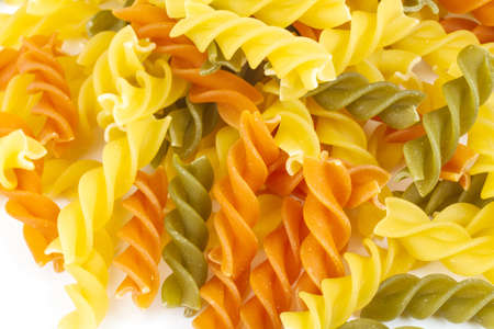 Uncooked pasta fusilli in different colours, white background Stock Photo - 12852524