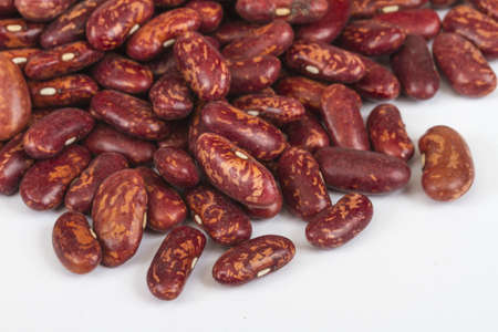 A handful of red beans. View from above. Isolated on white background. photo