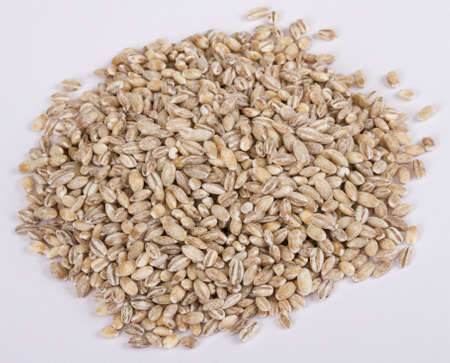 Pearl barley heap isolated on white Stock Photo - 12912188