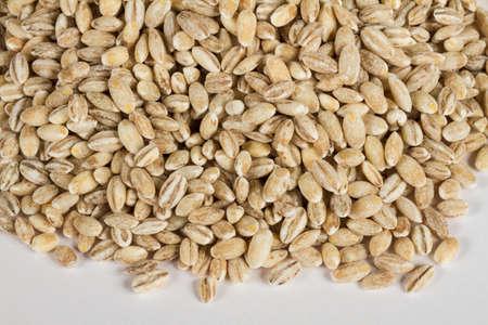 pearl barley: Pearl barley heap isolated on white