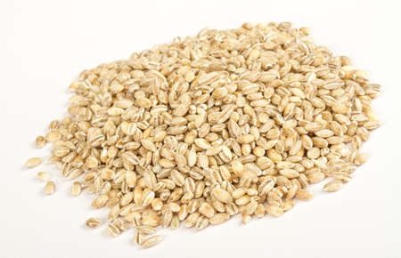 groat: Pearl barley heap isolated on white