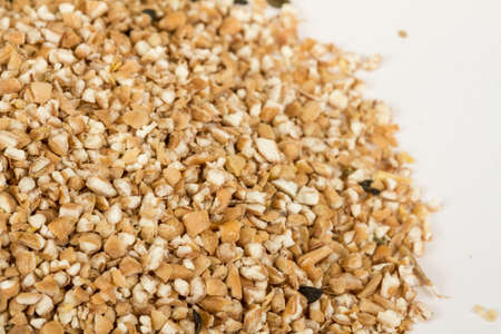 Pearl barley heap isolated on white photo