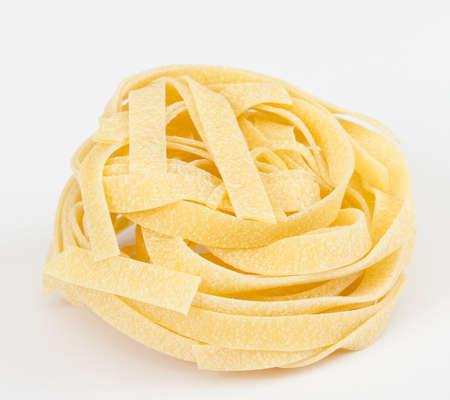 Italian pasta fettuccine nest isolated on white background photo