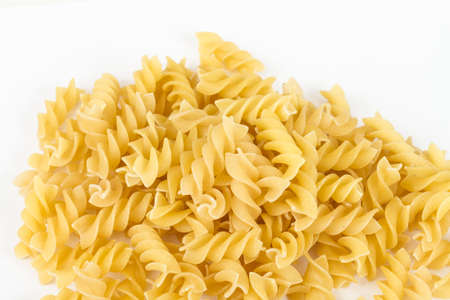 twists: A portion of Rotini corkscrew pasta isolated on white.