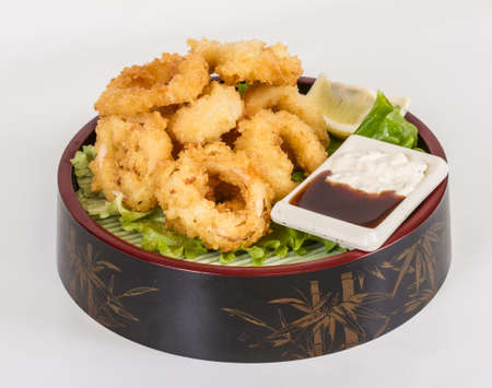 Deep batter fried squid rings calamari with green salad Stock Photo - 13079459