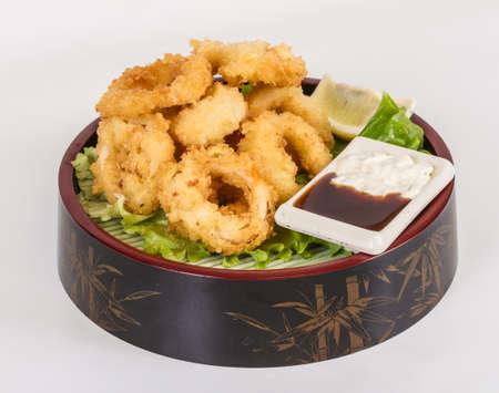 Deep batter fried squid rings calamari with green salad Stock Photo - 13079459