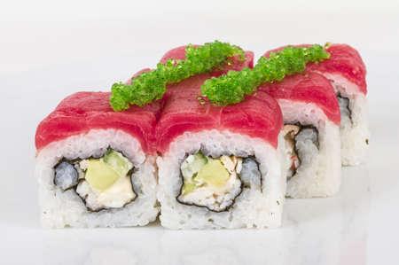 Maki Sushi - Roll made of Crab, avocado, cucumber inside. Fresh Tuna and tobico roe outside photo