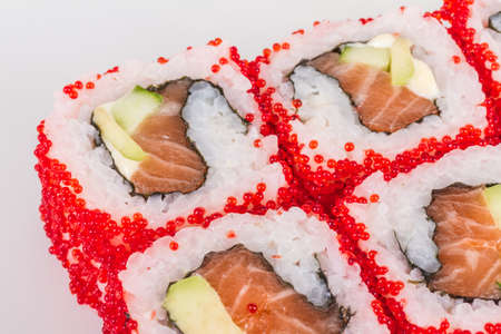 Tobiko Spicy Maki Sushi - Hot Roll with various type of Tobiko (flying fish roe) outside. Salmon, avocado and Green Lettuce inside Stock Photo - 13079822