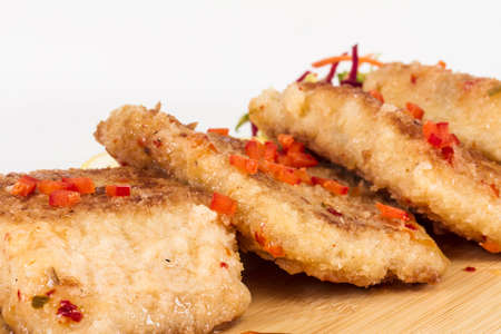 Fried fish fillets with  salad. photo
