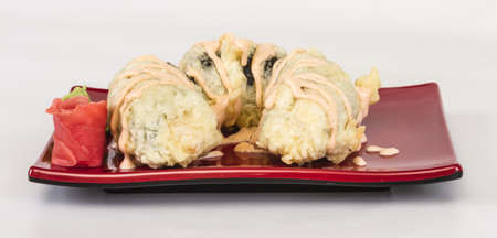 Japanese Cuisine -Tempura Maki Sushi (Deep Fried Roll made of salmon, tobiko roe and Cream Cheese inside) Stock Photo - 13078606